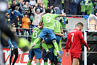 SEATTLE, WA - NOVEMBER 10: Kelvin Leerdam #18 of the Seattle Sounders FC is mobbed by teammates including Jordan Morris #13, Raul Ruidiaz #9, and Brad Smith #11 after scoring the game's first goal during a game between Toronto FC and Seattle Sounders FC at CenturyLink Field on November 10, 2019 in Seattle, Washington.