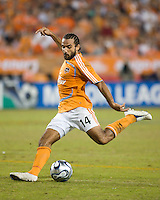 Houston Dynamo midfielder Dwayne De Rosarion (14) strikes the ball to score a goal in the 81st minute. The Houston Dynamo defeated the Kansas City Wizards 2-0 at Robertson Stadium in Houston, TX on November 10, 2007 to capture the MLS Western Conference Championship. The Houston Dynamo will take on the New England Revolution in the MLS Cup Final on November 18, 2007 at RFK Stadium in Washington D.C.