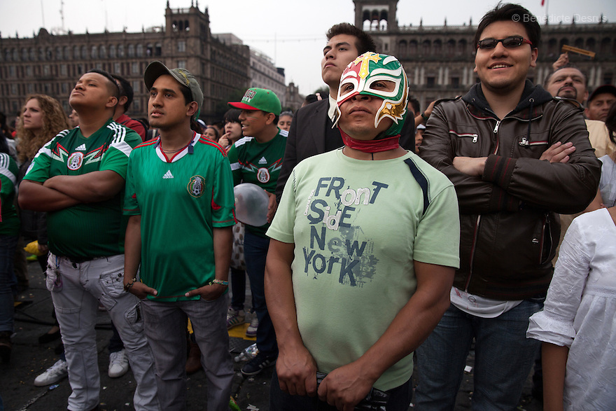 Thousands of fans gather to watch the transmission of the 2014 World Cup soccer match between Croatia and Mexico at the Zocalo main square in Mexico City on June 23, 2014. Mexico qualify from Group A with three late goals against Croatia. (Photo by Bénédicte Desrus)