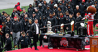 Head coach Urban Meyer leads his team to the stage area during the Ohio State football National Championship celebration at Ohio Stadium on Saturday, January 24, 2015. (Columbus Dispatch photo by Jonathan Quilter)