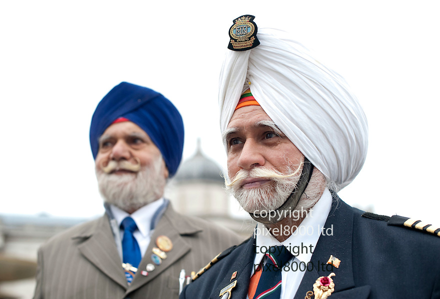 Sikh New Year Celebs London - Vaisakhi Festival Trafalgar Square  - May Bank Holiday..Pic shows: Two very smart Sikh gentlemen in the crowd. . Harphajan Singh Begun, 80, and Captian Gurmain Singh Notha, 73, from Southall....Every May sees Trafalgar Square transformed into a colourful celebration to welcome in the Sikh New Year. The Vaisakhi Festival is truly a sight to behold with traditional and modern Asian music and dancing and an array of exotic culinary delights on offer. The official date for Vaisakhi is 13th April, but the 2012 Vaisakhi festival in Trafalgar Square will be held in May. Commemorating 300 years of the consecration of Sri Guru Granth Sahib as the eternal Guru, the Vaisakhi includes performances of music such as Shabad Kirtin (religious hymns), as well as modern dance music and DJs. In previous years crowds of 30,000 have attended the celebrations, which end with a final prayer for the good and well-being of the whole of humanity....Picture by Gavin Rodgers/ Pixel8000. 07917221968
