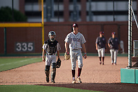 Mountain Ridge Mountain Lions starting pitcher Matthew Liberatore (32) and catcher Ryan Ellis (11) walk towards the dugout before a high school game against Sandra Day O'Connor High School at Brazell Field at GCU on April 19, 2018 in Glendale, Arizona. Mountain Ridge defeated Sandra Day O'Connor 2-1. (Zachary Lucy/Four Seam Images)