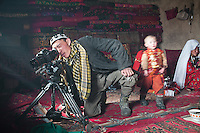 Abdul Sator, A young Kyrgyz looks into a camera..In and around the camp of Manara (Sufi camp), near the borders with China and Tajikistan...Trekking with yak caravan through the Little Pamir where the Afghan Kyrgyz community live all year, on the borders of China, Tajikistan and Pakistan.