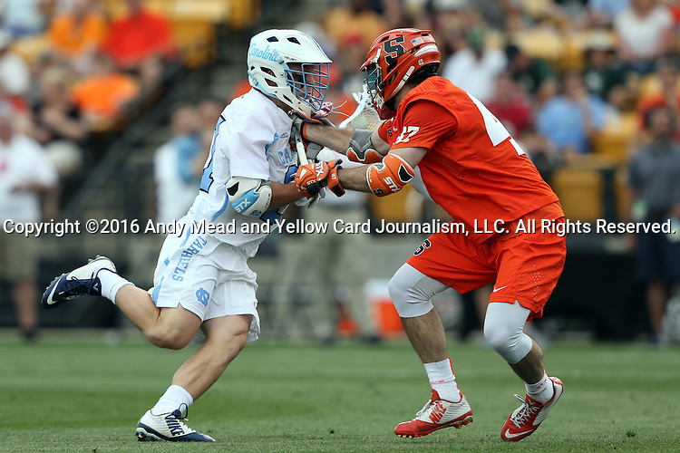 29 April 2016: Syracuse's Joe Gillis (right) tries to hold up North Carolina's Michael Tagliaferri (left). The University of North Carolina Tar Heels played the Syracuse University Orange at Fifth Third Bank Stadium in Kennesaw, Georgia in a 2016 Atlantic Coast Conference Men's Lacrosse Tournament semifinal match.