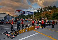 Jun 16, 2017; Bristol, TN, USA; Crew members for NHRA top fuel driver Leah Pritchett during qualifying for the Thunder Valley Nationals at Bristol Dragway. Mandatory Credit: Mark J. Rebilas-USA TODAY Sports
