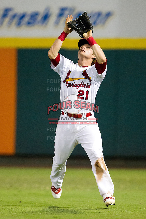 Aaron Luna (21) of the Springfield Cardinals makes a play on a fly ball to right field during a game against the Northwest Arkansas Naturals at Hammons Field on August 1, 2011 in Springfield, Missouri. Springfield defeated Northwest Arkansas 7-1. (David Welker / Four Seam Images)