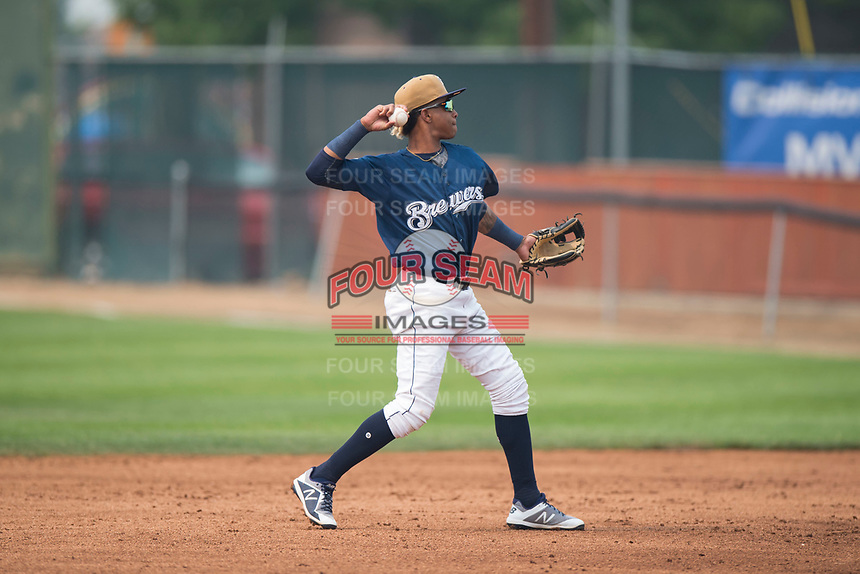 Helena Brewers second baseman Yeison Coca (2) throws to first base during a Pioneer League game against the Grand Junction Rockies at Kindrick Legion Field on August 19, 2018 in Helena, Montana. The Grand Junction Rockies defeated the Helena Brewers by a score of 6-1. (Zachary Lucy/Four Seam Images)