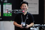 An exhibitor flies a drone DJI MAVIC PRO at CEATEC Japan 2016 on October 3, 2016, Tokyo, Japan. CEATEC Japan is a cutting-edge IT and electronics exhibition. This year 648 companies and organisations are taking part from 24 different countries and the show is open to the public from October 4 to 7. (Photo by Rodrigo Reyes Marin/AFLO)