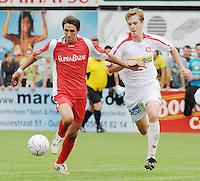 FC Gullegem - KSV Moorsele..duel tussen Gianni Leenaert (links) en Thomas Mestdagh (rechts)..foto VDB / BART VANDENBROUCKE