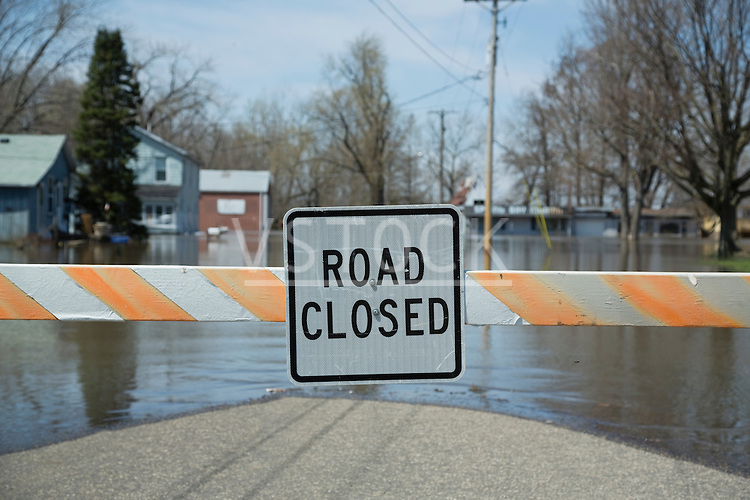 Close up of information sign at the end of flooded street