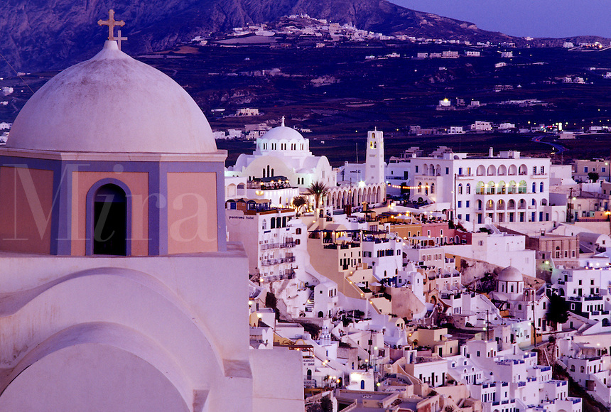Santorini, Greek Islands, Greece, Fira, Cyclades, Europe, Scenic view of the village of Fira from a church on the steep hillside of Santorini Island on the Aegean Sea.
