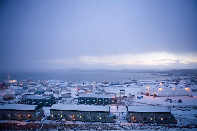 """The town of Iqaluit, Nunavut Territory, Canada after a light snowfall in early October. Iqaluit, with a population of 6,000, is the largest community in Nunavut as well as the capital city. It is located in the southeast part of Baffin Island. Formerly known as Frobisher Bay, the town is at the mouth of the bay of that name, overlooking Koojesse Inlet. """"Iqaluit"""" means 'place of many fish'. The image is part of a collection of images and documentation for Hungry Planet 2, a continuation of work done after publication of the book project Hungry Planet: What the World Eats, by Peter Menzel & Faith D'Aluisio."""