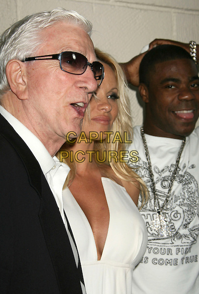 "PAMELA ANDERSON & LESLIE NIELSON .""Superhero Movie"" World Premiere held at the Mann Festival Theater, Westwood, California, USA, 27 March 2008..half length profile sunglasses .CAP/ADM/RE.©Russ Elliot/Admedia/Capital PIctures"