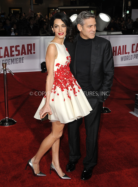 WWW.ACEPIXS.COM<br /> <br /> February 1 2016, LA<br /> <br /> Actor George Clooney (R) and his wife Amal Clooney arriving at the premiere of 'Hail, Caesar!' at the Regency Village Theatre on February 1, 2016 in Westwood, California. <br /> <br /> By Line: Peter West/ACE Pictures<br /> <br /> <br /> ACE Pictures, Inc.<br /> tel: 646 769 0430<br /> Email: info@acepixs.com<br /> www.acepixs.com