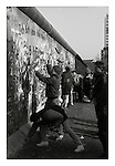 "Attacking the ""Stützwandelement UL 12.11"" (retaining wall element UL 12.11) or fourth-generation Berlin Wall (1975-80) with a sledge hammer from the West Berlin side, November 1989. 45,000 sections of reinforced concrete (12ft high by 4ft wide) were used to build this final version of the 95 mile long wall. Photograph copyright Graham Harrison."