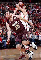 Ohio State Buckeyes guard Amedeo Della Valle (33) dodges Louisiana-Monroe Warhawks guard Kyle Koszuta (15) on his way to the basket during Friday's NCAA Division I basketball game at Value City Arena in Columbus on December 27, 2013. Ohio State led the game at halftime, 41-20. (Barbara J. Perenic/The Columbus Dispatch)