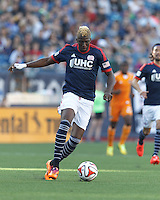 New England Revolution midfielder Saer Sene (39) on the attack. In a Major League Soccer (MLS) match, the New England Revolution (blue/white) defeated Houston Dynamo (orange), 2-0, at Gillette Stadium on April 12, 2014.