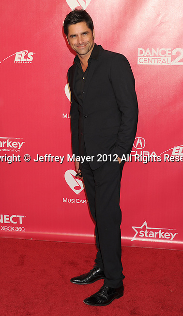 LOS ANGELES, CA - FEBRUARY 10: John Stamos arrives at The 2012 MusiCares Person of The Year Gala Honoring Paul McCartney at Los Angeles Convention Center on February 10, 2012 in Los Angeles, California.