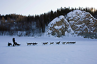 Jeff Kings team on Yukon River leaving Ruby 2006 Iditarod Alaska Winter