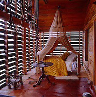 The wooden slats of the tree-house-like porch are inspired by local barn designs