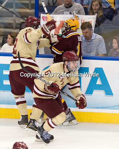 Kevin Hayes (BC - 12), Erik Haula (Minnesota - 19), Patrick Wey (BC - 6) - The Boston College Eagles defeated the University of Minnesota Golden Gophers 6-1 in their 2012 Frozen Four semi-final on Thursday, April 5, 2012, at the Tampa Bay Times Forum in Tampa, Florida.