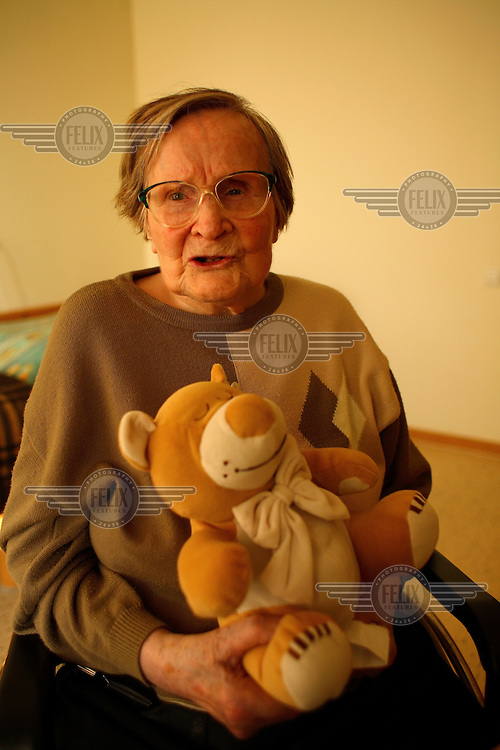 A woman sits with a stuffed bear. In 2007 there were over 8,400 nursing homes in Germany with 640,000 residents; a third of the elderly population of Germany. Their number is estimated to increase up to the year 2050, when it is predicted over 1.4 million elderly Germans will be in nursing homes. Other than the natural decline in health, the major problems faced by these residents is dementia and loneliness..
