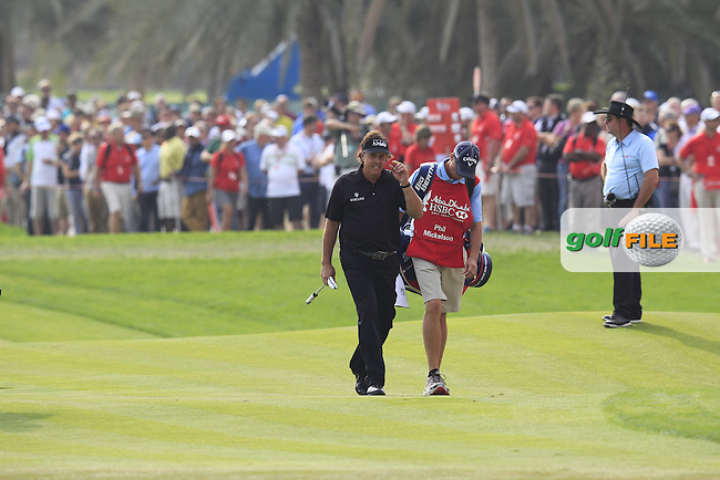 Phil Mickelson (USA) walks onto the 18th green during Sunday's Round 3 of the Abu Dhabi HSBC Golf Championship 2014 at the Abu Dhabi Gold Club, Abu Dhabi, United Arab Emirates.19th January 2014.<br /> Picture: Eoin Clarke www.golffile.ie