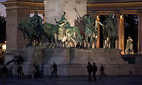 09 SEP 2010 - BUDAPEST, HUN - Children play and couples walk through Heroes Square after dusk (PHOTO (C) NIGEL FARROW)