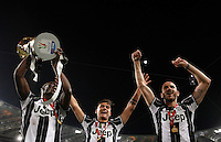 Calcio, finale Tim Cup: Milan vs Juventus. Roma, stadio Olimpico, 21 maggio 2016.<br /> Juventus&rsquo; Paul Pogba, left, flanked by teammates Paulo Dybala, center, and Leonardo Bonucci, holds up the trophy at the end of the Italian Cup final football match between AC Milan and Juventus at Rome's Olympic stadium, 21 May 2016. Juventus won 1-0 in the extra time.<br /> UPDATE IMAGES PRESS/Isabella Bonotto