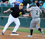 SIOUX FALLS, SD - MAY 20:  Chase Burch #23 from the Sioux Falls Canaries catches the ball as Ryan Babineau #2 from the Gary Southshore Railcats tries to beat the throw to first in the sixth inning Tuesday evening at the Canaries Stadium.  (Photo by Dave Eggen/Inertia)