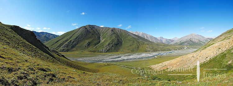 The Marsh Fork of the Canning River, located in Alaska's Arctic National Wildlife Refuge, between peaks in the Brooks Range as it flows north to the ocean
