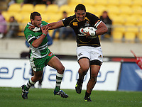 Wellington number eight Matthew Luamanu fends off Aaron Cruden. Air NZ Cup - Wellington Lions v Manawatu Turbos at Westpac Stadium, Wellington, New Zealand. Saturday 3 October 2009. Photo: Dave Lintott / lintottphoto.co.nz