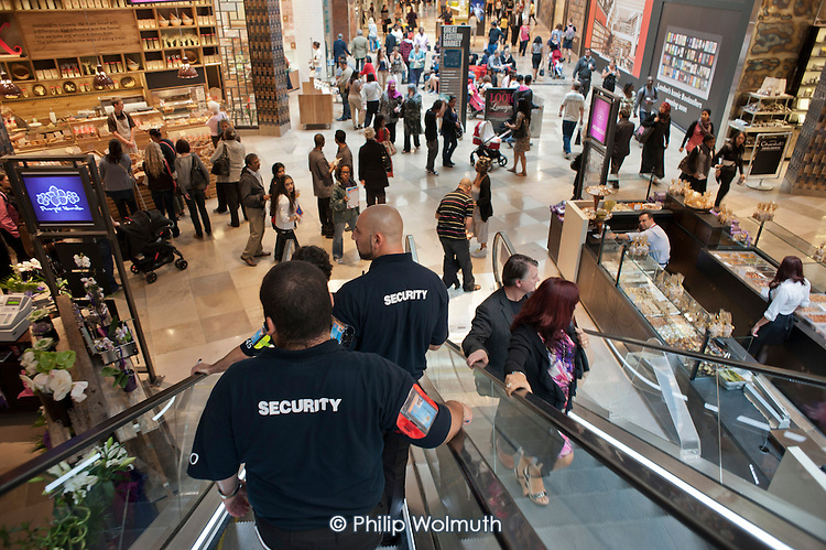 Security guards at Westfield Stratford City, the largest urban shopping centre in Europe. The new retail complex will be the gateway to the London 2012 Olympic Park. 2,000 of the 10,000 permanent jobs at the centre have gone to the local unemployed.