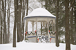 Eagles Mere gazebo in winter snow scene with Christmas wreaths.