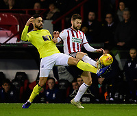 Blackburn Rovers' Derrick Williams vies for possession with Sheffield United's Oliver Norwood<br /> <br /> Photographer Chris Vaughan/CameraSport<br /> <br /> The EFL Sky Bet Championship - Sheffield United v Blackburn Rovers - Saturday 29th December 2018 - Bramall Lane - Sheffield<br /> <br /> World Copyright © 2018 CameraSport. All rights reserved. 43 Linden Ave. Countesthorpe. Leicester. England. LE8 5PG - Tel: +44 (0) 116 277 4147 - admin@camerasport.com - www.camerasport.com