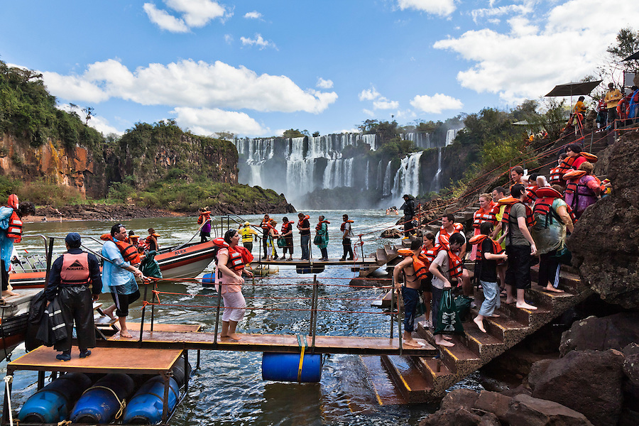 "Iguazu Falls as seen from Misiones, Argentina.  The name ""Iguazu"" means ""big water"" in Guarani, who were the original inhabitants of the region.  Today the falls, one of the largest and most spectacular in the world, are a popular tourist destination in both Argentina and Brazil."