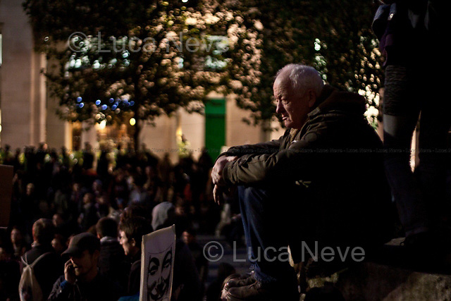 Chris Knight (Professor of Anthropology and political activist). <br /> <br /> London, 15/10/2011. St Paul's Square became the stage of the UK arm of the &quot;Occupy&quot; protest movement which has been growing around the world. The Occupy movement is a world-wide protest against the financial crises created by the actual financial system, by speculation, by deregulation, and by the actions of major international financial and investment banks. Around 2,000 protesters armed with tents and placards, gathered outside the famous Cathedral intending to occupy Paternoster Square, home of the London Stock Exchange and the heart of the City of London, but they were hampered by City police officers. After this failed attempt the protesters decided to camp in front St Paul's where the situation with police forces became immediately tense. Masked like the character of Guy Fawkes from the movie &quot;V for Vendetta&quot;, Julian Assange appeared on the square to give a speech in support of the protesters. During the late evening police forces heavily armed with riot control equipment charged the square, attempting to evict the occupants who resisted. Later in the evening the police retreated and the occupation continued peacefully.