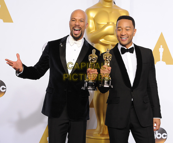 HOLLYWOOD, CA - FEBRUARY 22: (L-R) Common and John Legend with the award for Best Original Song at the 87th Annual Academy Awards at the Dolby Theatre on February 22, 2015 in Hollywood, California. <br /> CAP/MPI/PGFM<br /> &copy;PGFM/MPI/Capital Pictures Oscars