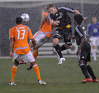 DC United defender Gonzalo Peralta (2) jumps to head the ball during the game. The game between DC United and the Houston Dynamo game was postponed due to bad weather on Wednesday June 4, 2008 at RFK Stadium.