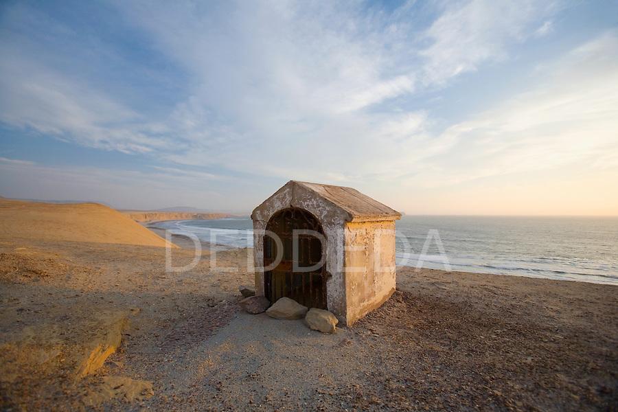 A grave site on the sand cliffs of Reserva Nacional de Paracas near Paracas and Pisco, Peru.