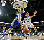 SIOUX FALLS, SD - February 13: Ellie Brecht #34 from Sioux Falls Lincoln applies pressure as Taylor Molstad #4 from Rapid City Stevens drives the baseline in the first half of their game Friday night at the Denny Sanford Premier Center. (Photo by Dave Eggen/Inertia)
