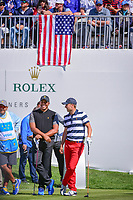 Jordan Spieth (USA) and Jhonattan Vegas (VEN) share a laugh on the first tee during round 4 Singles of the 2017 President's Cup, Liberty National Golf Club, Jersey City, New Jersey, USA. 10/1/2017. <br /> Picture: Golffile | Ken Murray<br /> <br /> All photo usage must carry mandatory copyright credit (&copy; Golffile | Ken Murray)