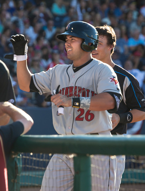 ICL frist basemen Chris Colabello get high fives after hitting a home run  during the Triple-A All-Star game played on Wednesday night, July 17, 2013 at Aces Ballpark in Reno, Nevada.