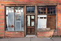 Old abandoned brick storefront building in Orchard, CO