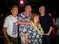 "HONOLULU, Turtle Bay Resort, North Shore, Oahu. - (Thursday, January 3, 2013) Greg Noll (USA) with wife Laura, Garrett MacNamara (HAW) and CBS reporter Anderson Cooper (USA), was the guest  speaker of Talk Story at Surfer The Bar tonight, Noll, nicknamed ""Da Bull"" by Phil Edwards in reference to his physique and way of ""charging"" down the face of a wave is an American pioneer of big wave surfing and is also acknowledged as a prominent longboard shaper. Noll was a member of a US lifeguard team that introduced Malibu boards to Australia around the time of the Melbourne Olympic Games. Noll became known for his exploits in large Hawaiian surf on the North Shore of Oahu. He first gained a reputation in November 1957 after surfing Waimea Bay in 25-30 ft surf when it had previously been thought impossible even to the local Hawaiians. He is perhaps best known for being the first surfer to ride a wave breaking on the outside reef at the so-called Banzai Pipeline in November 1964...It was later at Makaha, in December 1969, that he rode what many at the time believed to be the largest wave ever surfed. After that wave and the ensuing wipeout during the course of that spectacular ride down the face of a massive dark wall of water, his surfing tapered off and he closed his Hermosa Beach shop in the early 1970s. He and other surfers such as Pat Curren, Mike Stang, Buzzy Trent, George Downing, Mickey Munoz, Wally Froyseth, Fred Van Dyke and Peter Cole are viewed as the most daring surfers of their generation...Noll is readily identified in film footage while surfing by his now iconic black and white horizontally striped ""jailhouse"" boardshorts and was interviewed by host Jodi Wilmott (AUS). . Photo: joliphotos.com"