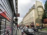 VMI Vincentian Heritage Tour: A massive shadow-produced mural appears on the wall as members of the Vincentian Mission Institute cohort walk along the outside of Vincent de Paul's apartment on the Rue du Faubourg Saint-Denis, Thursday, June 23, 2016, as they toured Vincentian sites in Paris. (DePaul University/Jamie Moncrief)