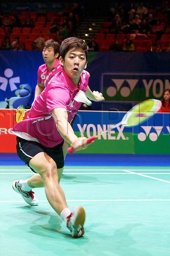 10.03.2012 Birmingham, England. Jing Jae Sung (KOR and Lee Yong Dae (KOR) in action during the Yonex All England Open Badminton Championships at the National Indoor Arena.