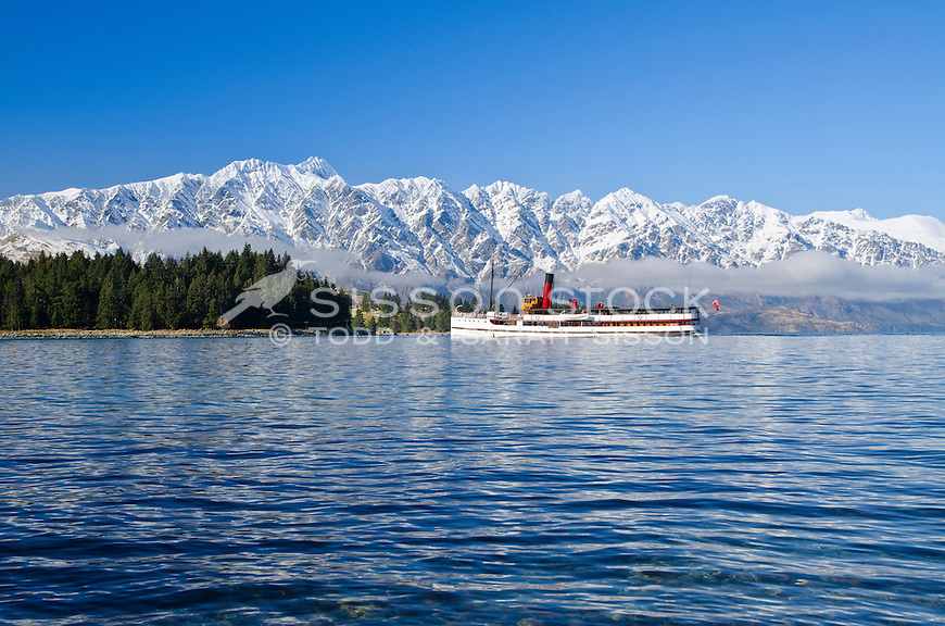 New Zealand Photos | TSS Earnslaw steamship cruises past Queenstown Gardens snow covered Remarkables Mountains
