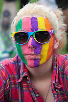 Girl with Rainbow Colored Face Paint & Glasses, PrideFest, Seattle, WA, USA.