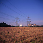 A295G9 Sizewell nuclear power station and electricity pylons crossing field Suffolk England